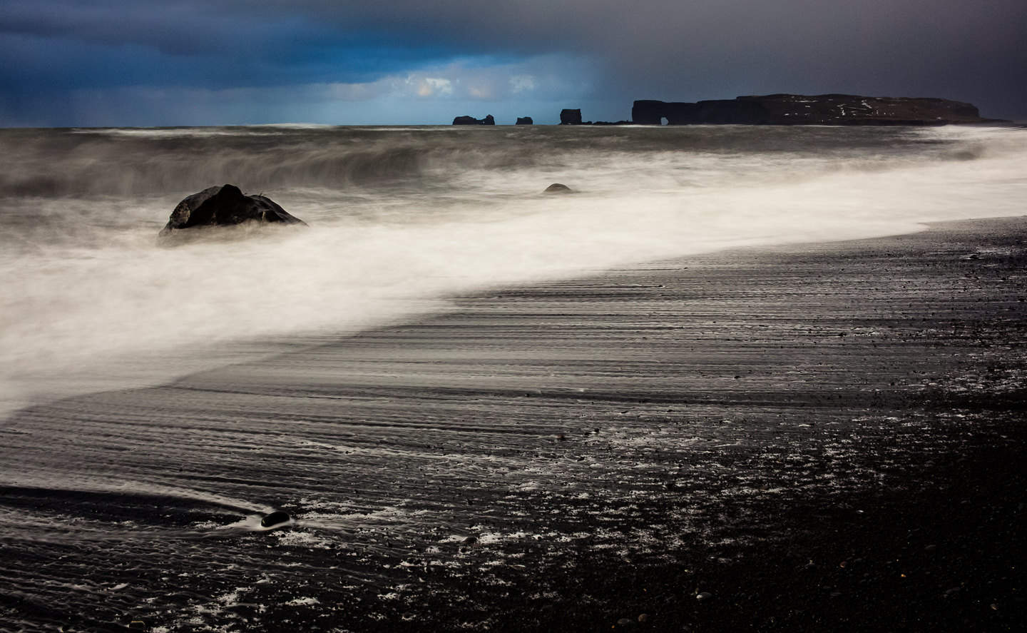 A Winter Storm Pushes The Waves Onto Black Pebble Beach In Vik Iceland