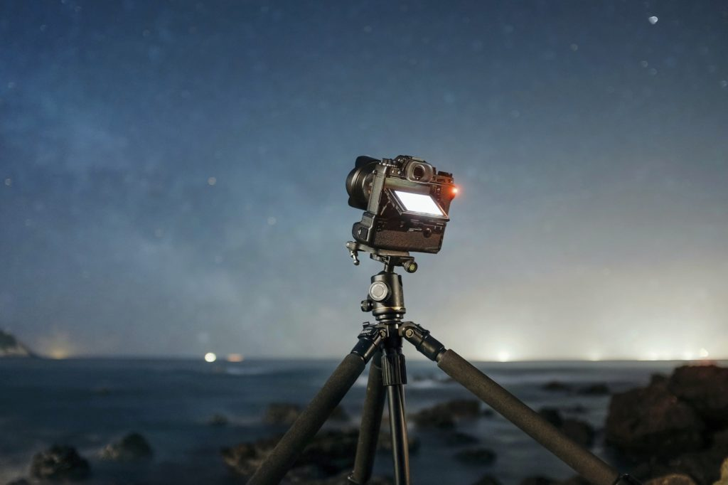 camera set up on tripod at night